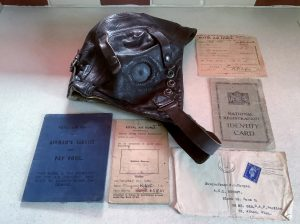 Aircraftman's helmet, paybook, identity card, leave form 1945.